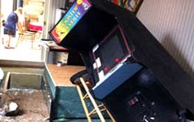 Arcade game without earthquake straps and seismic fasteners to prevent damage and potential injury