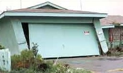 Leaning single storey garage did not have a seismic retrofit to prevent earthquake damage