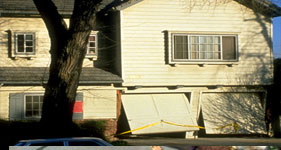Garage with living space above damaged by earthquake.